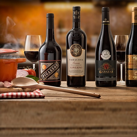 A selection of red wines on the kitchen table