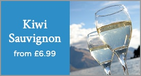 Kiwi Sauvignon from £6.99. Two glasses of white wine with New Zealand mountainous landscape in the background